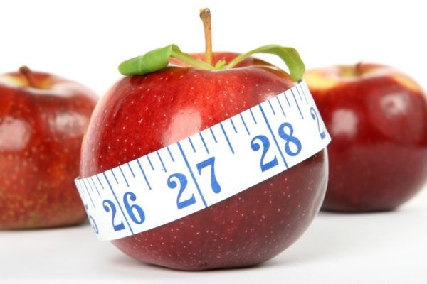 measuring tape around an apple
